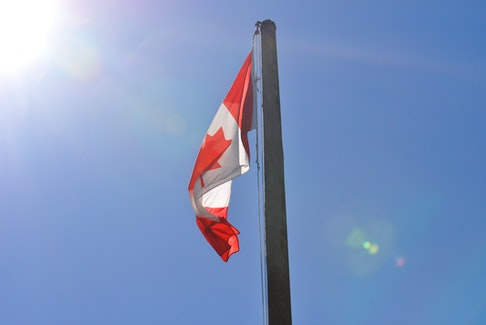 Exactly 215 hours after it was lowered, the Canadian flag at the Anglican Cathedral of St. John the Evangelist in Corner Brook was raised again on Wednesday to honour the 215 Indigenous children whose remains were found at a former residential school in Kamloops, B.C.