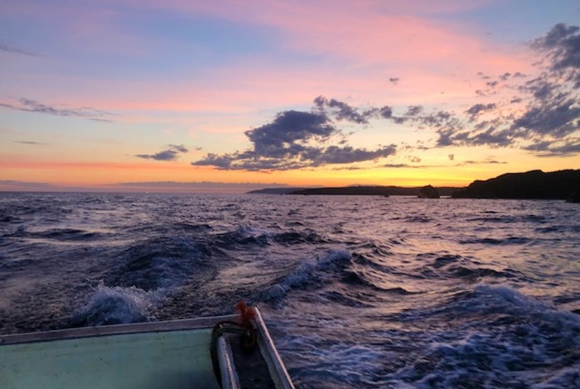 """Jeffrey Campbell took this photo from the deck of On the Bruin at 6 a.m. Thursday with captain Grant Campbell and Josh Hawley as they passed along the northwest tip of Port Hood Island in Cape Breton. They were turning south along the island toward Henry Island. It was a great day for hauling lobster. """"Yes, the captain is a Bruins fan and the deckhands are Habs fans, but we all hate the Leafs. LOL"""" Thanks, Jeffrey, for this photo."""