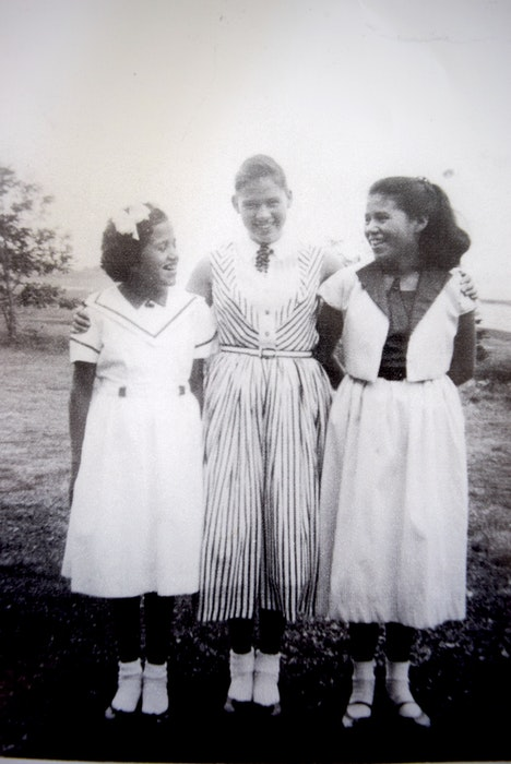 Eleanor, Mary Kay and Jane pictured wearing nice clothes at home that would later be taken away at residential schools. They were the youngest of 11 siblings and Jane is the last one surviving. - Contributed