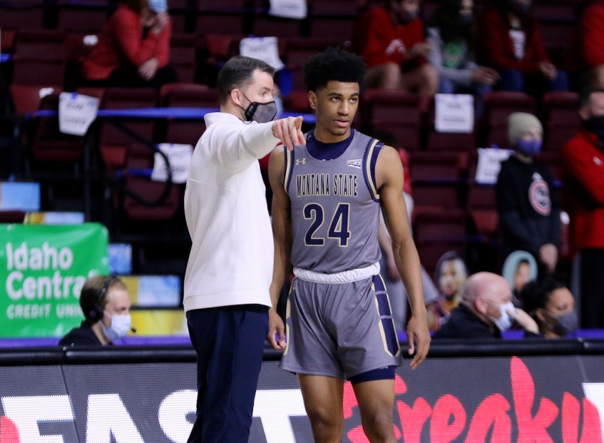 Kellen Tynes, right, is given direction by Montana State head coach Danny Sprinkle during a 2020-21 NCAA Division 1 basketball game. - Montana State University - Contributed