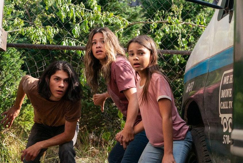 From left, Lucius Hoyos, Gina Rodriguez and Ariana Greenblatt in Awake.