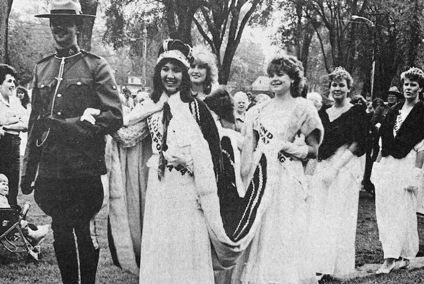 Julianne Doucette, Princess Windsor 1985, was crowned Queen Annapolisa at the 54th Apple Blossom Festival. Pictured here is the queen and her royal party being escorted back to Windsor by RCMP Const. Guy Roy.