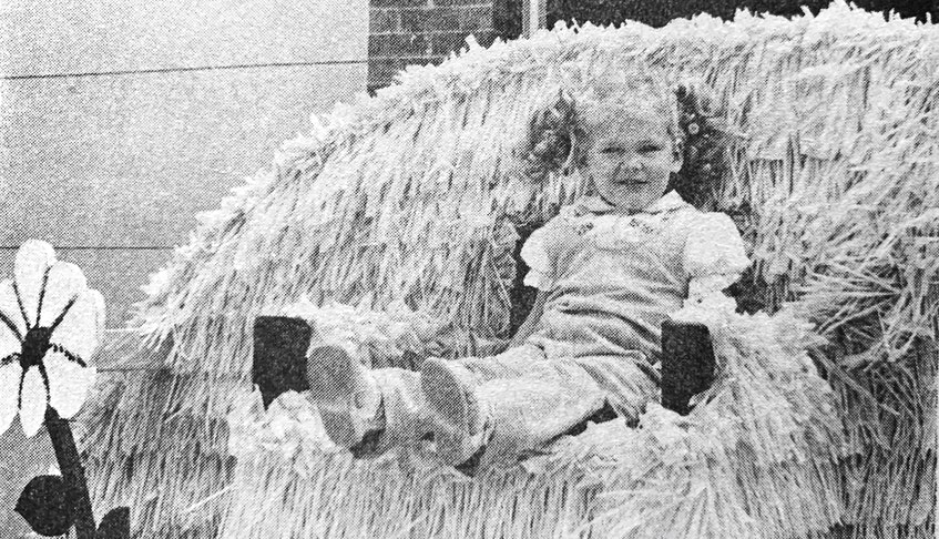 Three-year-old Candace McCulloch tried out Princess Windsor's throne on the town's Apple Blossom Festival parade float entry in 1986. It came second place for most outstanding float in the parade. - File Photo