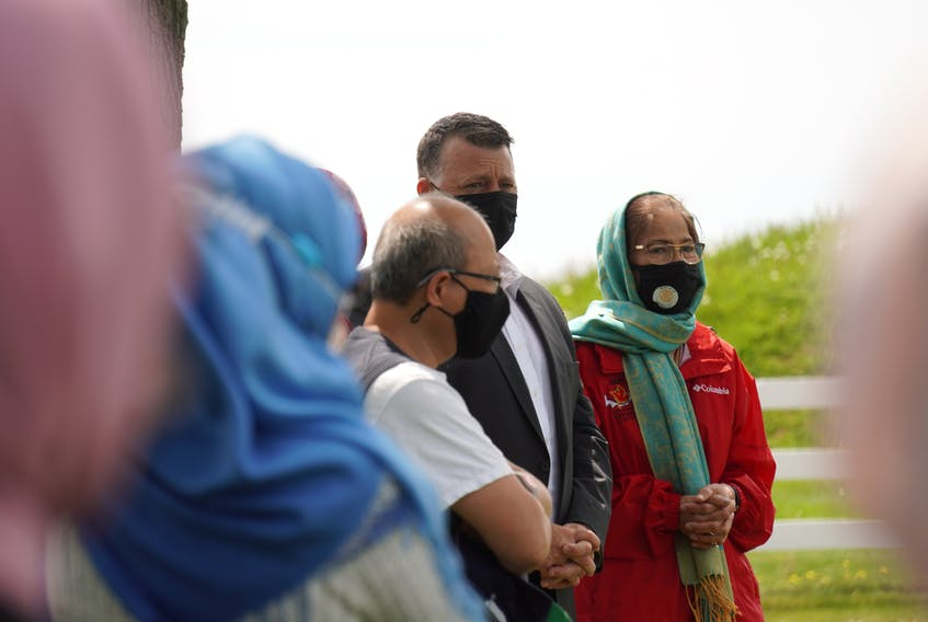 Farida Chishti, right, stands beside P.E.I. premier Dennis King during a Charlottetown vigil in memory of the four Muslims killed in Ontario on June 6. Daniel Brown • The Guardian