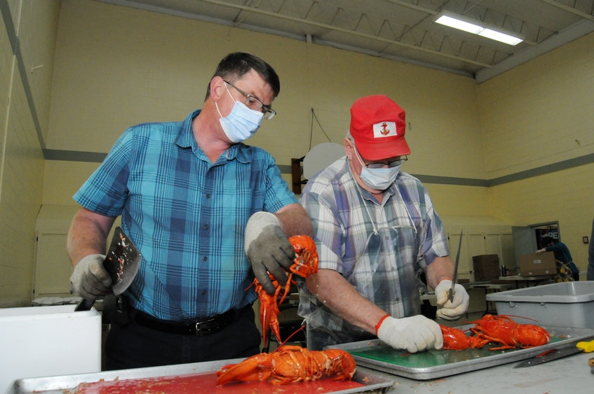 John Templeton (left) and Bruce Templeton are part of one of the family bubbles set up to do preparation work at the St. Andrew's parish hall Wednesday morning. — Joe Gibbons/The Telegram
