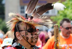 Jake Maloney from the Indian Brook First Nations listens to speeches made in the Peace And Friendship Park in Halifax Thursday.