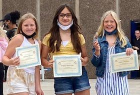 Students at Dr. T. L. Sullivan School in Florence, Jocelyn Billard, Poppy MacLean and Claire Phillips, show off their grading certification, happy to be heading into Grade 7 next year. CONTRIBUTED