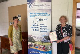 Cumberland-Colchester MP Lenore Zann presents Tatamagouche Centre executive director Nanci Lee with a certificate of appreciation. Tatamagouche Centre is receiving $120,000 in federal funding to make energy-efficient retrofits to its Stewart Hall.