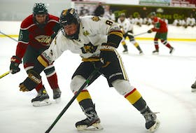 Charlottetown Bulk Carriers Knights forward Jude Campbell, right, protects the puck during a game against the Kensington Monaghan Farms Wild during the 2020-21 season at MacLauchlan Arena in Charlottetown. The Summerside D. Alex MacDonald Ford Western Capitals selected Campbell with their first pick, 24th overall, in the Maritime Junior Hockey League Entry Draft on July 10.