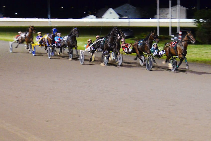 Time To Dance leads the field at the halfway mark of the 53rd running of the $25,000 Governor's Plate, presented by Summerside Chrysler Dodge, in 1:53.1 at Red Shores at Summerside Raceway on July 10.