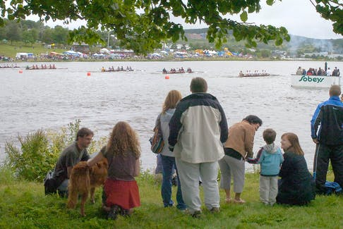 In this file photo, spectators watch the start of a race at the Royal St. John's Regatta, with concessions shown in the distance on the shoreline on The Boulevard side of Quidi Vidi Lake. The Regatta is going ahead this year, but while there will be rowing, there won't be concessions.