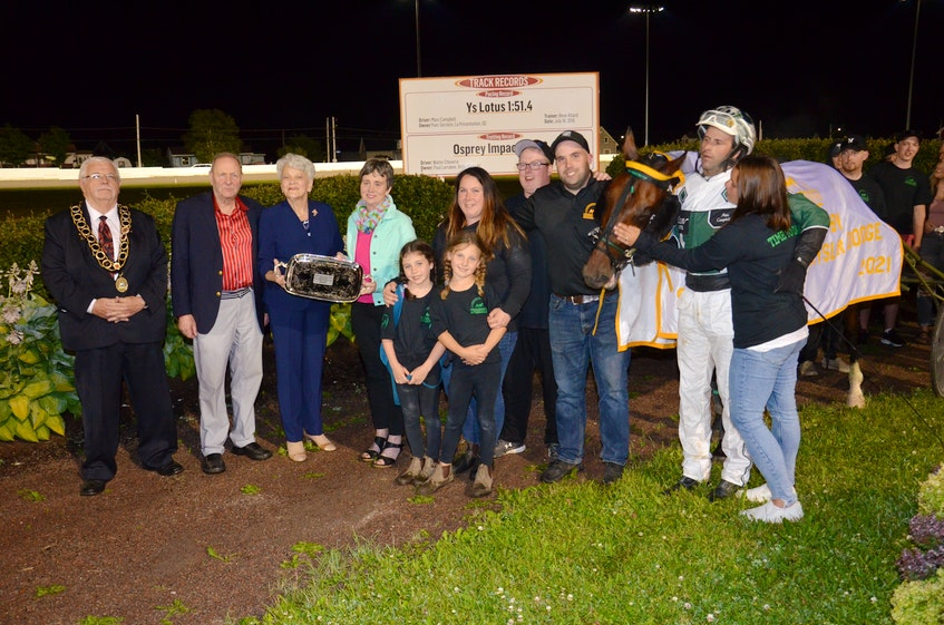Time To Dance won the 53rd edition of the $25,000 Governor's Plate, presented by Summerside Chrysler Dodge, in 1:53.1 at Red Shores at Summerside Raceway on July 10. P.E.I. Lt.-Gov. Antoinette Perry, third left, presents the 2021 Governor's Plate to Jacinta Campbell, wife of the late Richard Campbell. Richard, who died July 6, shared ownership in Time To Dance with his son, Brent Campbell, and Matthew Mcdonald. Also taking part in the presentation, from left, are Summerside Mayor Basil Stewart, Warren Ellis of Summerside Chrysler Dodge, Brent's wife, Ambyr Campbell, and their two daughters, Mylah (left) and Brielle; Bo Ford, assistant trainer; Brent Campbell, who also served as the groom and trainer and driver Marc Campbell and his wife, Natasha. - Jason Simmonds • The Guardian