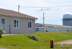 A residential neighbourhood on the site of the former CFB Sydney radar base will become the first net-zero energy community in Nova Scotia once a field-sized solar panel garden is up and running. The $1.8-million renewable energy project was announced Monday. DAVID JALA/CAPE BRETON POST