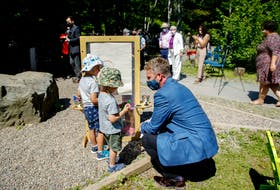 Nova Scotia premier Iian Rankin, speaks with a couple of youngsters prior to an announcement about early learning and child care on Tuesday at Mount Saint Vincent University's Child Study Centre, in Halifax. - Tim Krochak