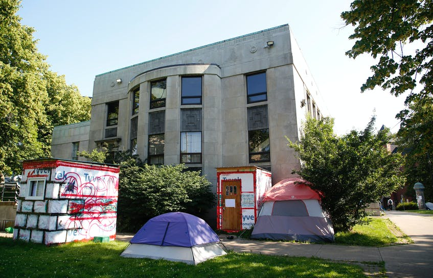 Shelters and tents are seen in front of the former public library on July 13, 2021, in Halifax. - Tim Krochak / File