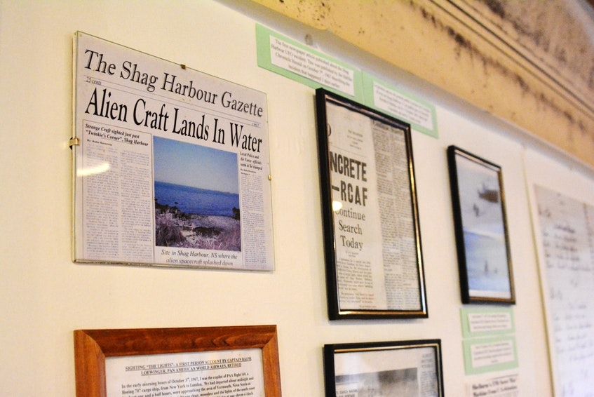 Framed newspaper clippings of the 1964 Nova Scotia incident adorn a wall at the Shag Harbor UFO Center in Shelburne County.  - Tina Comeau