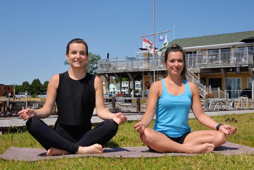 Jenna Shinn, left, and Neally Currie, co-owners of the Salt & Sol Restaurant and Lounge in Charlottetown, have launched Sunday morning yoga classes to give people a mental health break.