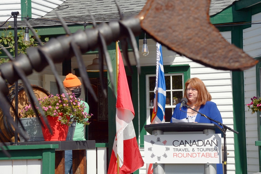 Brenda O'Reilly (right) of O'Reilly's Pub speaks at a press conference at Mallard Cottage Tuesday morning. At left is Todd Perrin, owner of the cottage. —, Keith Gosse/The Telegram