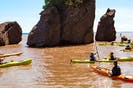 Hopewell Rocks are one of New Brunswick's premier tourist attractions and feature the highest tides in the world. Visitors can go at low tide and walk to the rocks, or at high tide via kayak. - Hopewell Rocks photo