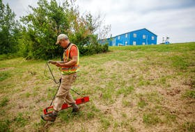 FOR DEMONT STORY: Archaeologist Jonathan Fowler, uses an electro-magnetometer near the site of the former Shubenacadie residential school near Shubenacadie, NS Monday July 12, 2021. Fowler is taking part in the burial investigation.  TIM KROCHAK PHOTO