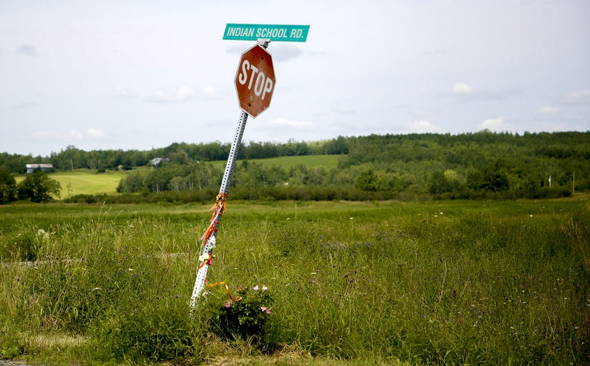 A road sign for Indian Schoo Road is seen near the site of the former Shubenacadie residential school near Shubenacadie, NS Monday July 12, 2021. The site of the former residential school, is undergoing an electomagnetic survey for residential school burial sites. - Tim Krochak