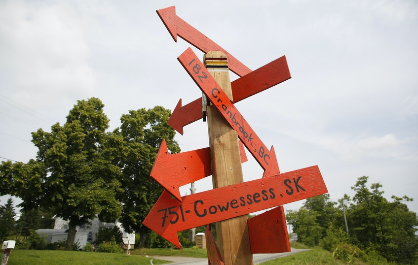 Directions towards other known residential school burial sites, are seen at a roadside memorial near the site of the former Shubenacadie residential school near Shubenacadie, NS Monday July 12, 2021. The site of the former residential school, is undergoing an electromagnetic survey for residential school burial sites  - Tim Krochak