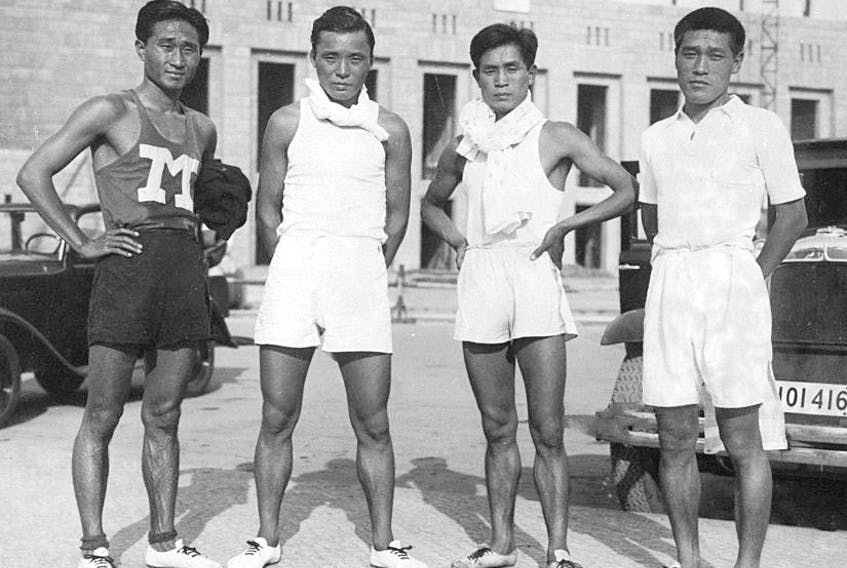 Shoryu Nan or Nam Sung-yong, Tamao Shiwaku, Fusashige Suzuki and Kitei Son or Son Gi-jeong pose for photographs after a training ahead of the Berlin Olympic on June 19, 1936 in Berlin, Germany.