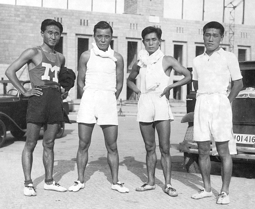 Shoryu Nan or Nam Sung-yong, Tamao Shiwaku, Fusashige Suzuki and Kitei Son or Son Gi-jeong pose for photographs after a training ahead of the Berlin Olympic on June 19, 1936 in Berlin, Germany. - SaltWire Network