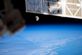 The moon, pictured during a lunar eclipse on May 26, 2021, is seen from the International Space Station during a northwest to southeast orbital trek 263 miles above the Pacific Ocean. When the sun is close to a lunar node, and the full moon is near the node as well, a lunar eclipse occurs. - NASA photo
