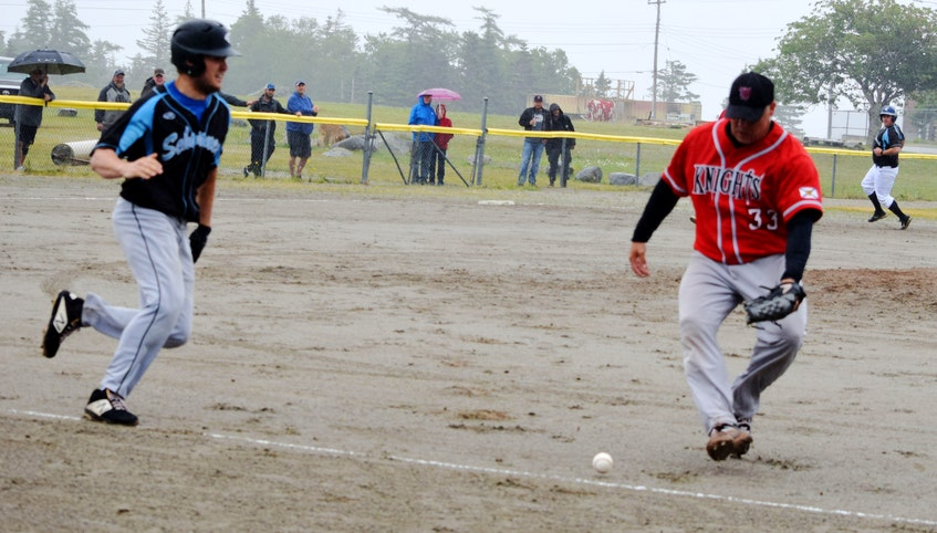 The rain didn't stop the game nor the fans from the attending the season opener for the Sherose Island Schooners in the Nova Scotia Intermediate Baseball League on July 4 at the Sherose Island ball field. KATHY JOHNSON - Kathy Johnson