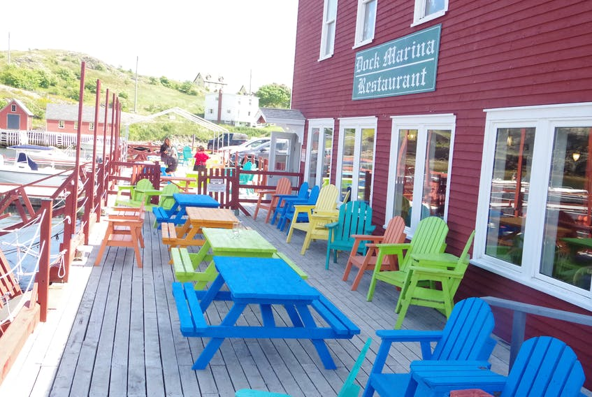 At the Dockside Marina in Trinity the tables are ready for diners on the outside deck.