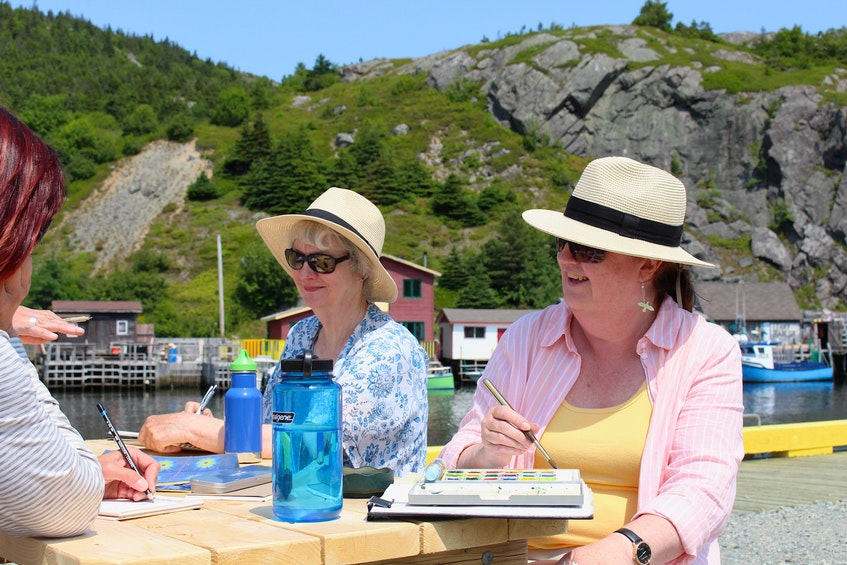 Bea Courtney and Rolayne Lewis-Bartlett sat down with friends at Quidi Vidi Wharf to enjoy an afternoon of painting and drawing.  They said the new seasonal event is vibrant and strengthens the community.  -Andrew Waterman