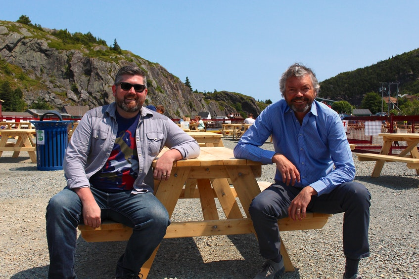 General manager and co-owner of Landwash Brewery Chris Conway sits with Mark Dobbin, the founder and president of Newfoundland-based investment firm Killick Capital Inc. In partnership with Business and Arts NL, Dobbin's company created The Wharf at Quidi Vidi to provide an opportunity to experience local art, beer and food for tourists and locals alike. - Andrew Waterman