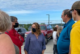 Municipality of Yarmouth councillor Sheri Hurlburt speaks with some of the protesters outside the Yarmouth Municipal Building. CARLA ALLEN • TRICOUNTY VANGUARD