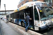 A passenger steps onto a Metro Transit bus on Barrington Street in Halifax Thursday July 15, 2021.   TIM KROCHAK PHOTO