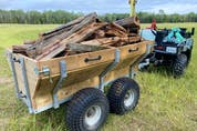 A Hubley trailer in action on Steve Maxwell's farm. Lots of room, dumping capabilities and walking beam suspension make this trailer work exceptionally well.