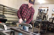 Allan building a walking beam for one of his trailers.