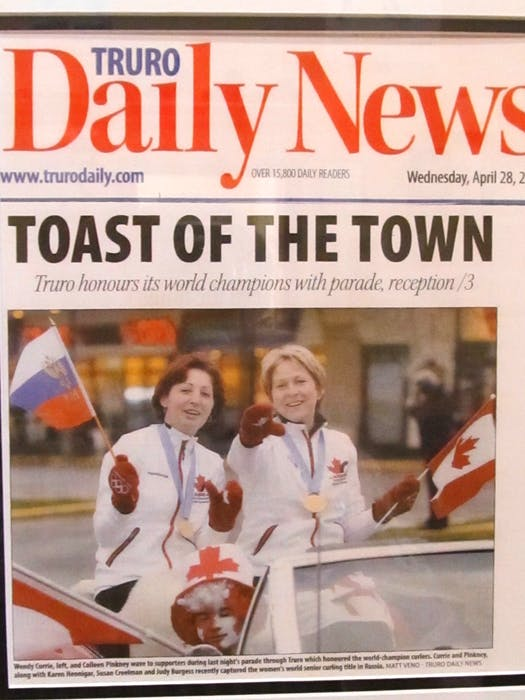 A front-page story during April of 2010, Wendy Currie, left and Colleen Pinkney wave to supporters during a parade to honour 'Team Pinkney' and a  world championship victory. - Contributed