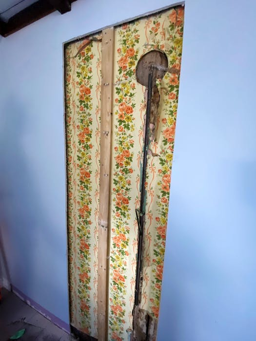 """Exposing an old (original) interior wall with successive layers of wallpaper covering a surprise """"find."""""""