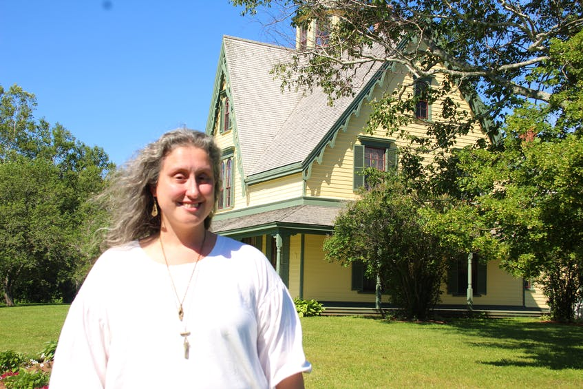 Site manager Caitlyn Paxson stands outside the Yeo House in Green Park, where she'll be giving ghost tours this summer.