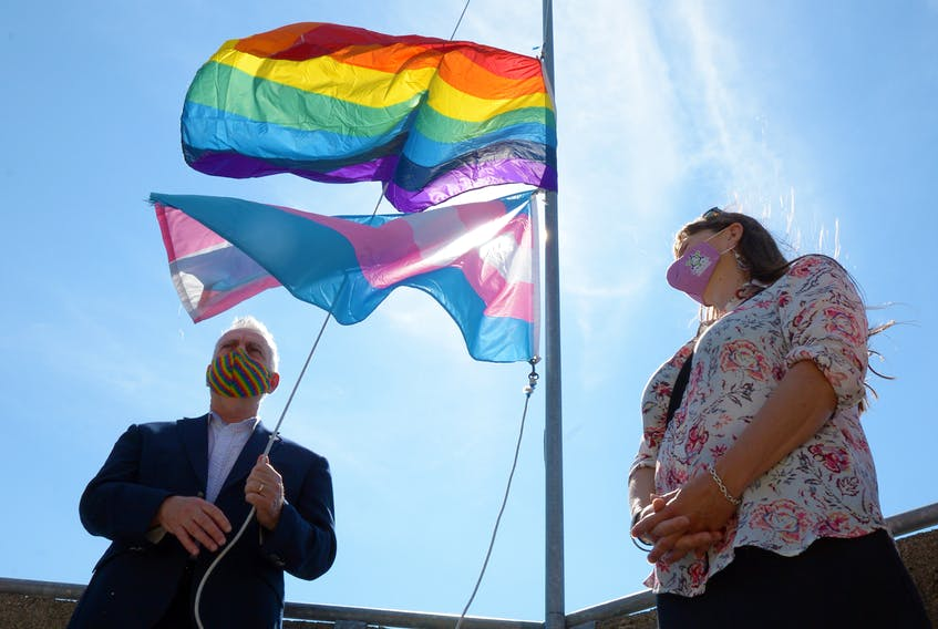 St. John's mayor Danny Breen raises the Pride flag at St. John's city hall Friday morning at the start of Pride Week 2021 festivities. At right is deputy mayor Sheilagh O'Leary.  Keith Gosse/The Telegram