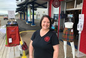 Deana Lloy stands outside her newly opened retail store, Red Label Kilts, located at the Joan Harriss Cruise Pavilion on the Sydney waterfront. Along with goods like purses, haggis and tartan jewelry, the shop has a tartan design station for clients to consult with Lloy. NICOLE SULLIVAN • CAPE BRETON POST