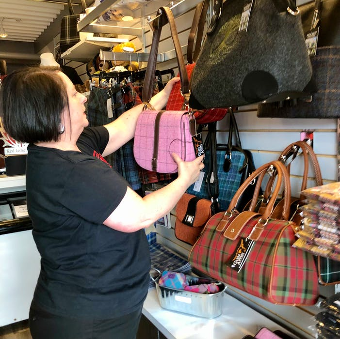 Deana Lloy arranges one of the walls of merchandise at her store on the Sydney waterfront. The tartan/kilt designer has been in business for 26 years and planning to open a retail shop for the past five. NICOLE SULLIVAN • CAPE BRETON POST