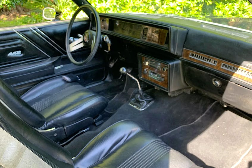 Custom bucket-seat interior with 442 badging and a four-speed manual transmission are features of Russ Hallbauer's restored Oldsmobile. Alyn Edwards/Postmedia News