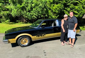 Russ and Dawn Hallbauer with the freshly restored 1978 Oldsmobile 442 that Russ bought new 43 years ago. Alyn Edwards/Postmedia News