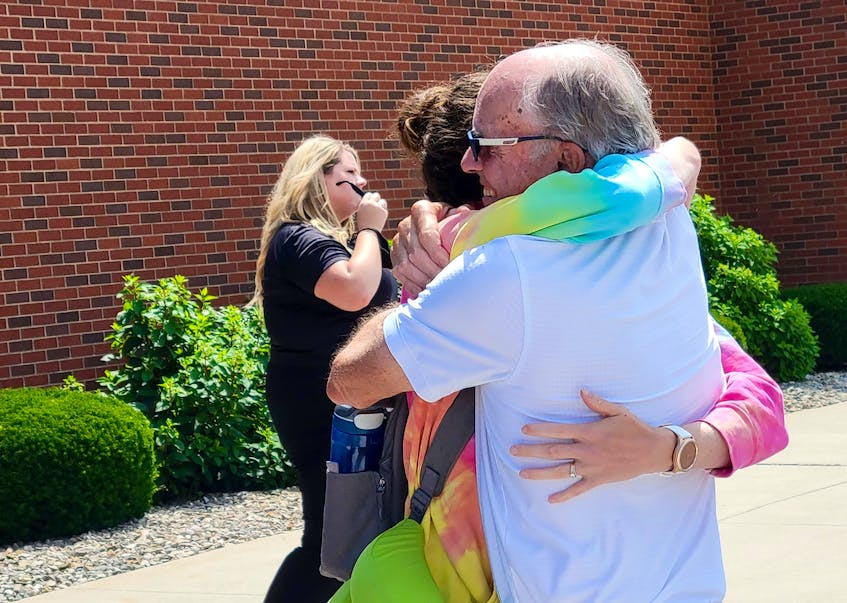 Visitors and residents embrace at the Charlottetown Airport after non-essential flights are allowed back into the province.