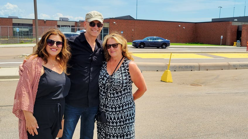 Vickie Fitzpatrick, left, finally gets to see her brother, Brian, centre, and sister-in-law, Donna for the first time in two years after the province reopened to Canadians with two vaccines.