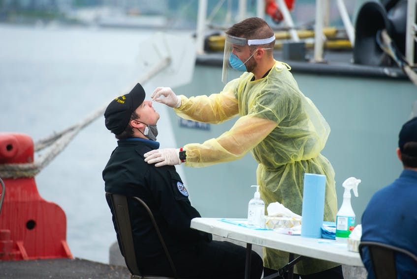 A sailor from HMCS Halifax gets a PCR test at CFB Halifax on Monday, July 19, 2021. The Halifax returned home on Monday as scheduled, however, a member of the crew tested positive for COVID-19 so the entire crew needed to get tested upon their arrival.