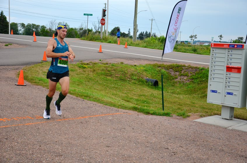 Michael Bergeron of Stanley Bridge checks his time as he hits the finish line in the 43rd annual Callbeck's Home Hardware Dunk River Road Race in Bedeque on July 26, 2020. Bergeron finished first overall in 40 minutes 59 seconds (40:59).