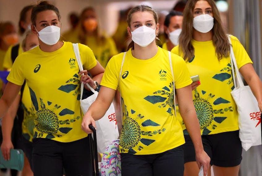 Members of Australian team walk to take the COVID antigen test at Narita airport in Tokyo.